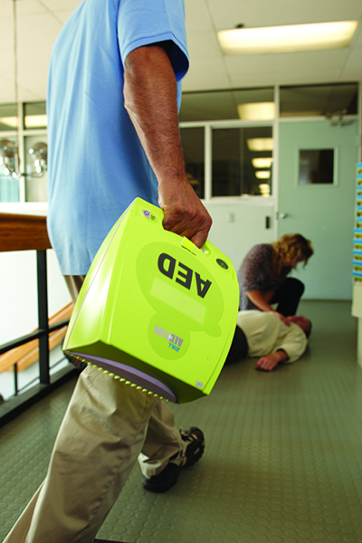 Man holding AED Plus