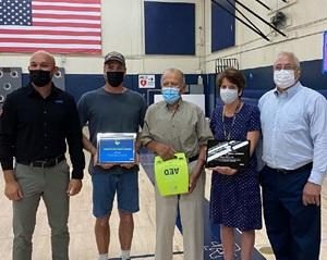 Roger Garcia (ZOLL Public Safety Sales), Jeff Haut (rescuer), Julio Salcedo (survivor), Karen Harris (rescuer/school nurse), and Dave DiPietro (distributor)